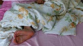 folhas : human foot, bed and human foot coming out from under the quilt,