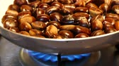 cooked chestnuts stands in a pan, chestnut cooking entertainment, boiled chestnut, chestnut cooking.