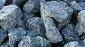 durva : large pebbles laid on railway tracks, speed railway, small pieces of rock used in construction,