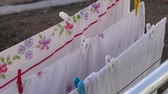 服 : drying clothes on the balcony, the balcony is drying bed linens, balcony clothesline and pegs,