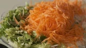 winter salad, grated lettuce and carrot radish, 動画素材