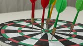 flechette : red, green and yellow colored dart arrow,