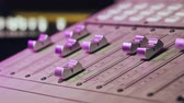 sztereó : Professional Recording Studio. Interface of equipment for sound processing. Fader. Different modes of audio console. Process of working on song or voice. Neon violet knob light