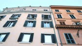 епископ : Apartment building streets in Rome. Windows with shutters. Facades of old houses in the streets of Italy. Traveling concept. Slow motion. 4k Стоковые видеозаписи
