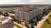 dormitory : Flying above old construction. AERIAL: Flight over dormitory area under clear blue sky. Summer sunny day. Building with apartments. Drone view. HD footage.