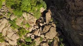 резной : Aerial view. Flying over beautiful canyon in wild nature landscape, Drone flies at summer season. The river flowing between the rocks to descent down