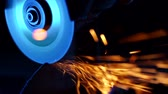溶接機 : Close-up of welder grinding smooths steel and iron using modern equipment. Industrial production, locksmith industry concept. Sparks from grinding wheel. 動画素材