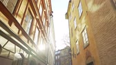 Apartment building streets in Stockholm area at winter. Scandinavian facades of old town houses in the narrow streets. Traveling concept. Slow motion. Steadicam shot