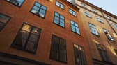 Apartment buildings on european streets in old northern city. Scandinavian windows. Facades of colorful houses in narrow streets of Stockholm, Sweden. Traveling concept. Slow motion. Steadicam shot Wideo