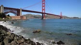 híd : Waves and Golden Gate Bridge - California Stock mozgókép