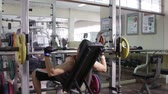 young : Fitness and lifestyle concept,Muscular man working out in gym.