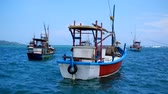 ceylon : Colorful boats of fisherman on blue water in sri lanka.