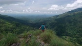 hiking trail : Traveler Man walking on mountains and coming to the edge of hill. View from mini Adams peak in Ella Sri Lanka