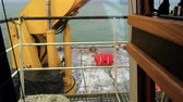 rigging : View from the bridge deck of the tug on anchor buoy. Powered winch. Daytime. Swell on the Baltic Sea.