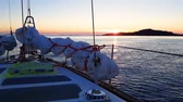 Amazing view of sunset from yacht deck sailing in sea