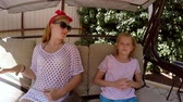 sevastopol : Two sisters talk on the swings in the summer