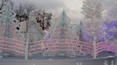 sallanan : Beautiful white Christmas scene with trees and large decorations Stok Video