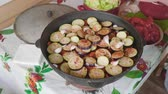 зубок чеснока : Hands of white cook add garlic cloves into large cooking pot with vegitables 3.