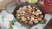 add : Hands of white cook add garlic cloves into large cooking pot with vegitables 4.
