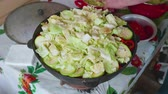 slané : Hands of white cook puts cabbage and parsley on it in large cooking pot with vegitables. Dostupné videozáznamy