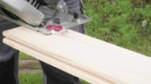 bucks : Carpenter cuts board with circular saw. Slow motion view. Stock Footage