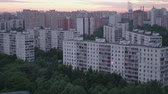 dormitory : View of sky with moving clouds over big city in summer evening