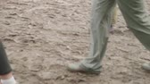 mocsok : Legs of people in rubber boots walking in mud after rain. Slow motion Stock mozgókép