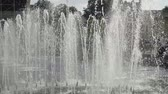 View of water jets in fountain in center of city on sunny day Wideo