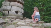 ismeretlen : Young caucasian blonde teenager look at the ancient dolmen. Left side view