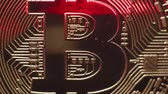 no idea : Red laser beam slides from top to bottom on surface of real coin Bitcoin