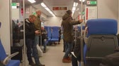 yeraltı : MOSCOW - CIRCA NOVEMBER 2017: People standing and sitting in carriage of train of Moscow central circle Stok Video
