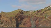 эстакада : View of Madeira island with its cliffy shore, white houses and buildings, roads and trestles. View from sailing yacht