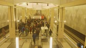 pendulares : MOSCOW - CIRCA APRIL, 2018: View of people on platfromm of metro station. Camera goes goes down