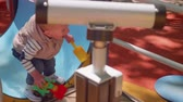 selfish : Little blond boy gets out of tunnel on playground. Slow motion view