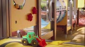 delightful : View of toy tractor on playground in park