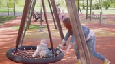 como : Little boy gets of swing on playground