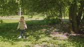 ангельский : Little blond boy watches something and them begin to move. Slow motion