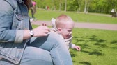ангельский : Little boy jumps out of hands of his mom