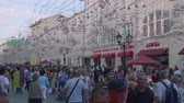soccer background : Tousrists, fans and locals walk along nikolskaya street in Moscow