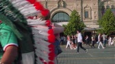 worldcup : Pair of people hug each other on red square in Moscow Stock Footage