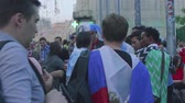 worldcup : MOSCOW - CIRCA JUNE, 2018: Football fans from Uruguay drink beer on Nikolskaya street in moscow