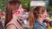tunisian flag : Side view of two football female fans in fan zone