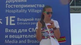 worldcup : MOSCOW - CIRCA JULY, 2018: Valunteer girl on stilts entertains football fans before football match in Luzhnkik stadium Stock Footage