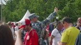 worldcup : MOSCOW - CIRCA JULY, 2018: Policeman makes video of what happens around near luzniki stadium