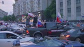 soccer background : MOSCOW - CIRCA JUNE, 2018: View of cars on road with Russian flags and fans aftter Russia won match Russia vs Spain Stock Footage