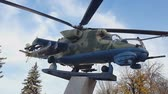 Russian helicopter Mi - 24 monument. Military combat transport helicopter in classic camouflage color.