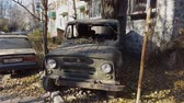 Rusty old abandoned car. Retro old Soviet Russian jeep UAZ. Steadicam shot.