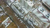 Construction of high-rise buildings in the winter. Aerial view. Dostupné videozáznamy