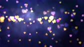 Glowing hearts appear on the shining blue background. Valentines Day holiday abstract loop animation.