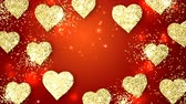 Gold shining hearts sparkle on the red background with place for text. Valentines Day holiday abstract loop animation. Vídeos